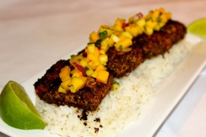 Jerk Mahi Mahi with coconut ginger rice topped with tropical pineapple salsa