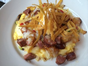 Southwest Frittata with pork chorizo, potatoes, onions, peppers, pepper jack cheese, crisp tortilla strips and sour cream